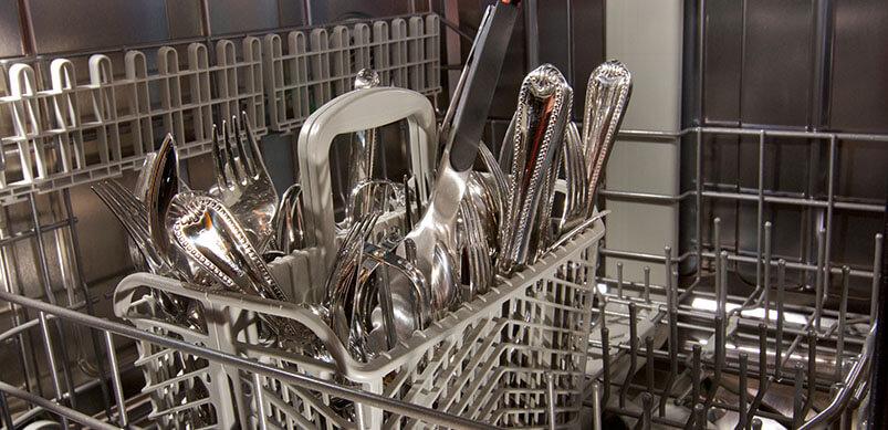 Close Up On Cutlery Inside Dishwasher
