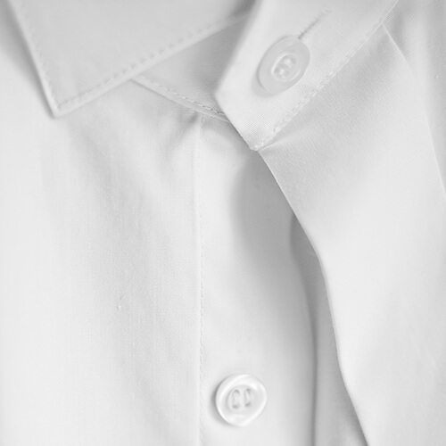 Close Up On White Shirt Buttons