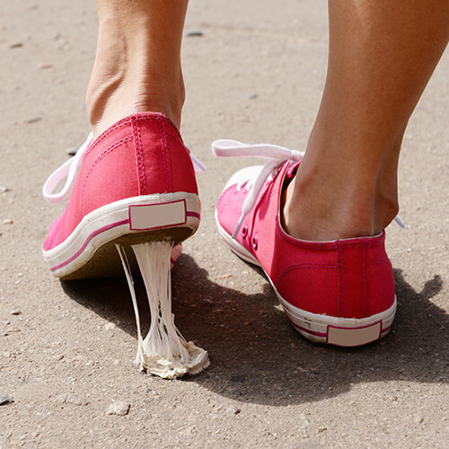 Shoe Stuck In Chewing Gum On Street