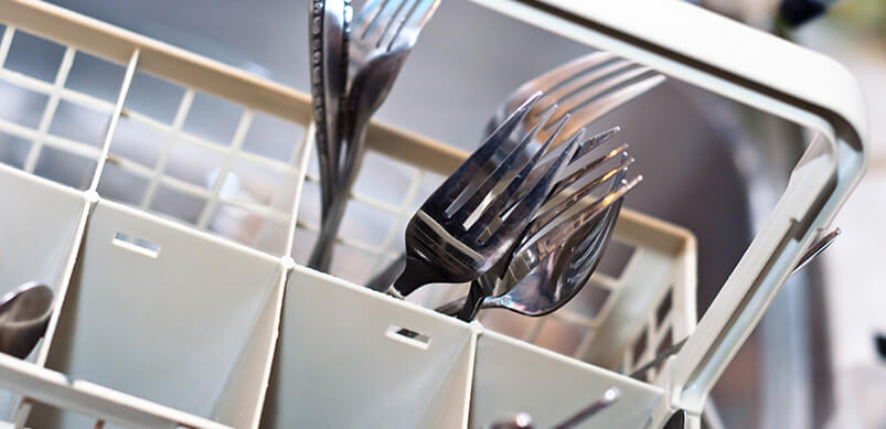 Close Up On Cutlery In Basket