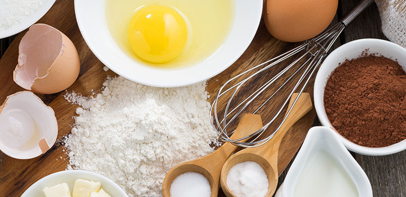 Baking Ingredients And Equipment On Wooden Board