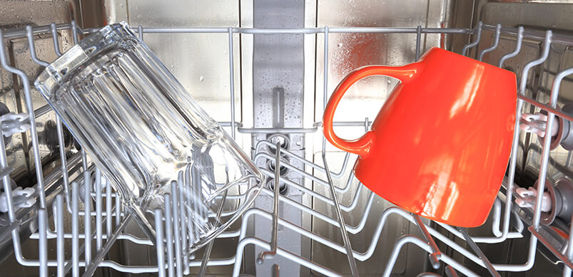 Glass And Orange Mug In Dishwasher
