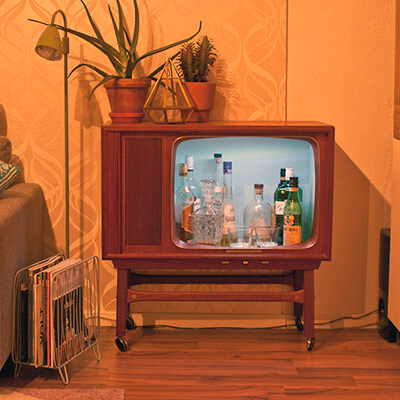 Old Fashioned TV With Drink Bottles Inside