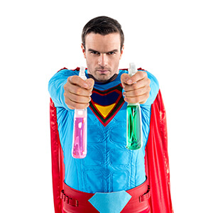 Man In Superhero Cape Holding Cleaning Sprays