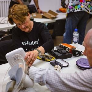 Woman From Restart Project Fixing Fan
