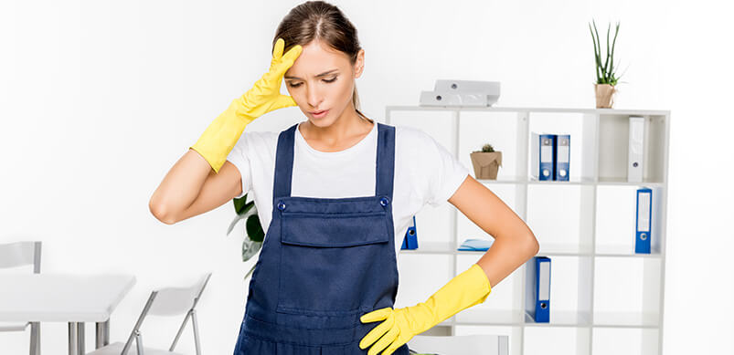 Woman In Rubber Gloves Looking Stressed