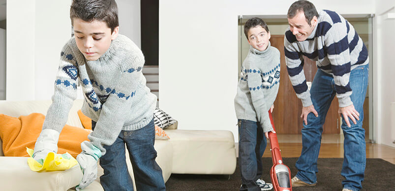 Father And Two Sons Doing Household Chores