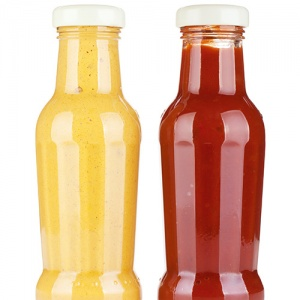 Two Sauces In Glass Bottles