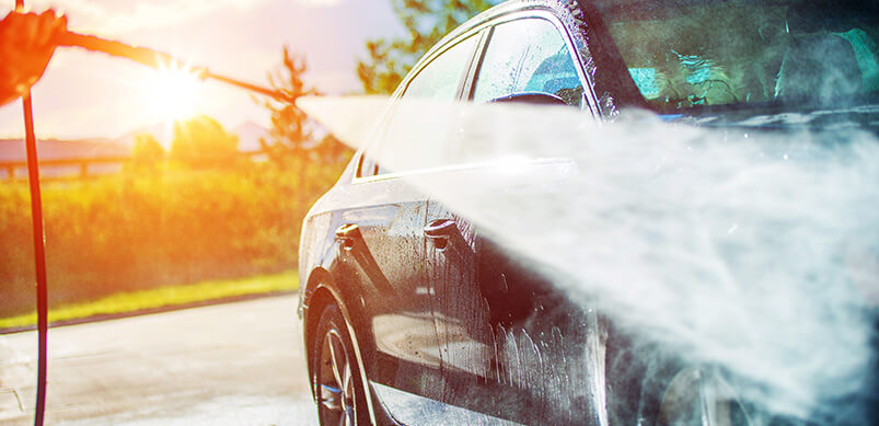 Car Being Washing With Pressure Washer