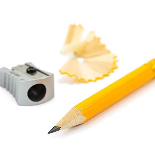 Pencil, Sharpener and Shavings On White Background