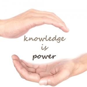 Words 'Knowledge Is Power' Held In Hands