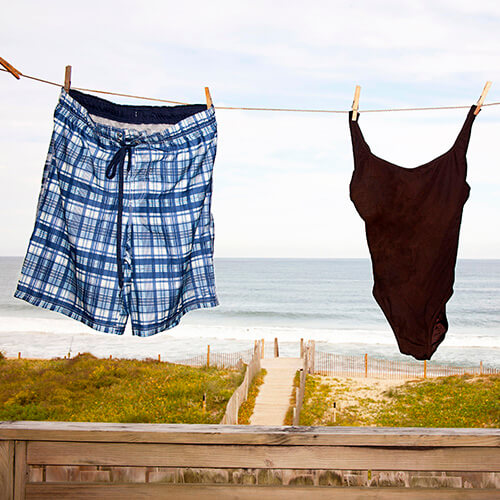 Swim Suit And Trunks On Washing Line