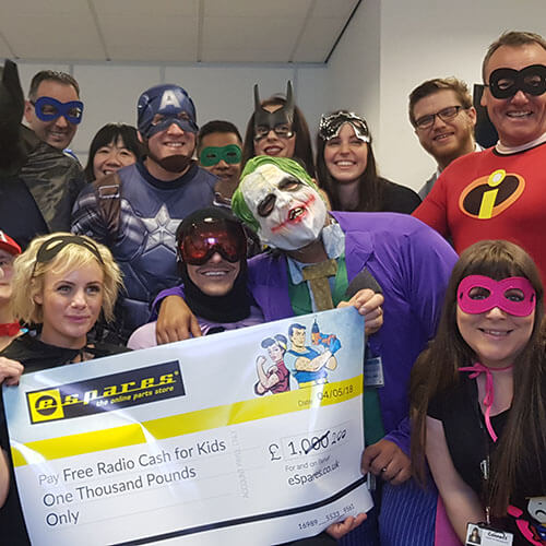 Team Dressed As Superheros For Cash For Kids