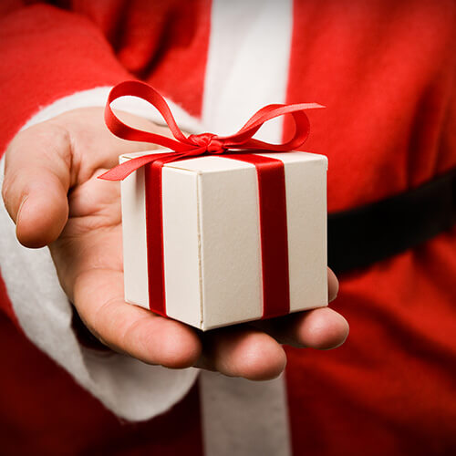 Santa Claus Holding Gift In Hand