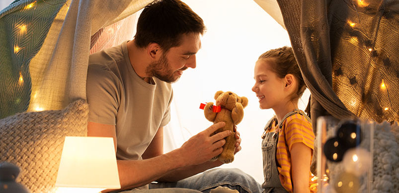 Father Playing With Daughter And Her Toys
