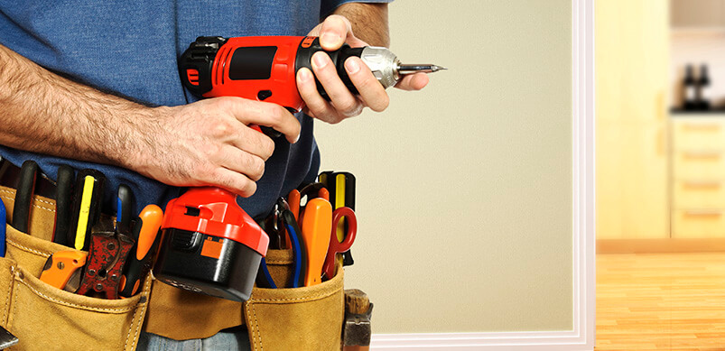 Man Wearing A Belt Full Of Tools