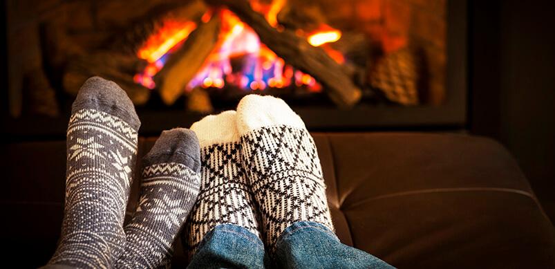 Feet In Wool Socks Warming By Fire