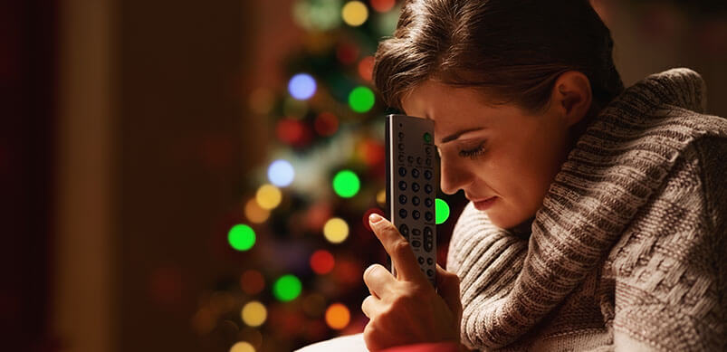 Frustrated Woman Holding TV Remote