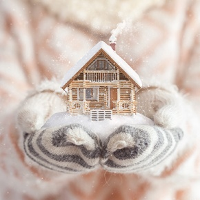 Woman In Gloves And Jumper Holding Home
