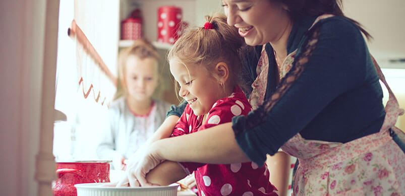 Mum And Daughter Cooking Together