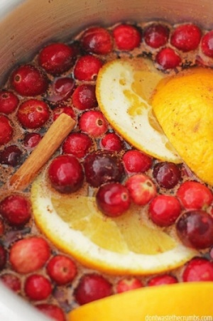 Oranges Cranberries And Spices In Slow Cooker