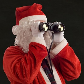 Santa With Binoculars And Christmas Checklist Background