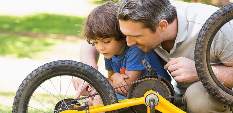 Dad Teaching Son To Fix Bike