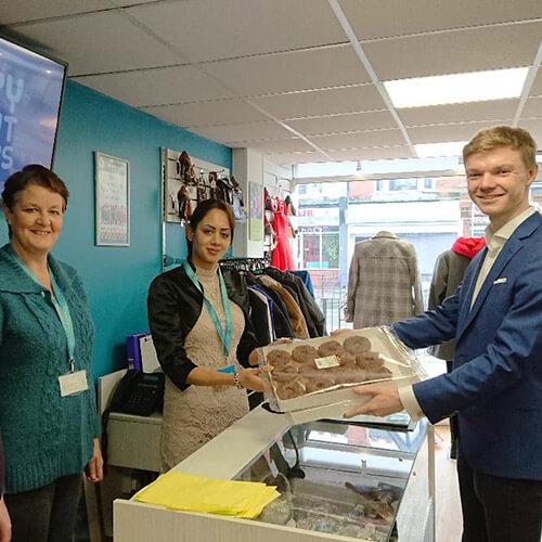 Jack Handing Donuts to Wylde Green Team