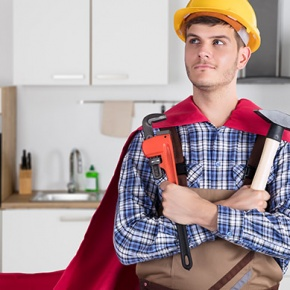 Man In Cape Holding Work Tools