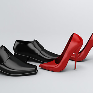 Mens Black Shoes And Womens Red Shoe Together