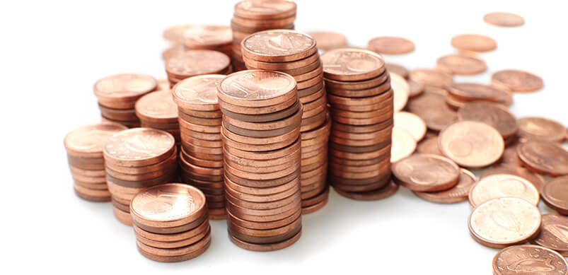 Piles Of Pennies On White Background