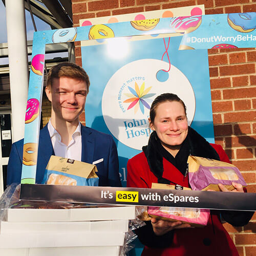 Eleanor And JAck Holding Donuts Outside Hospice