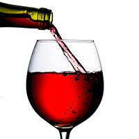 Bottle Pouring Wine Into Glass