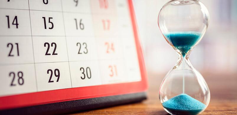 Hourglass Next To Calendar