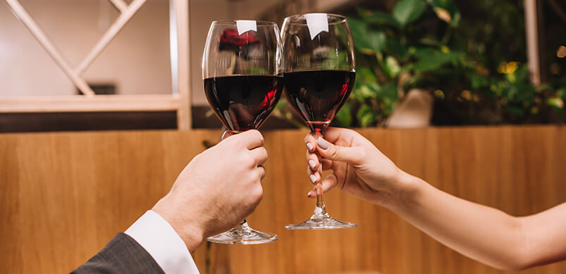 Couple Doing Cheers With Wine Glasses