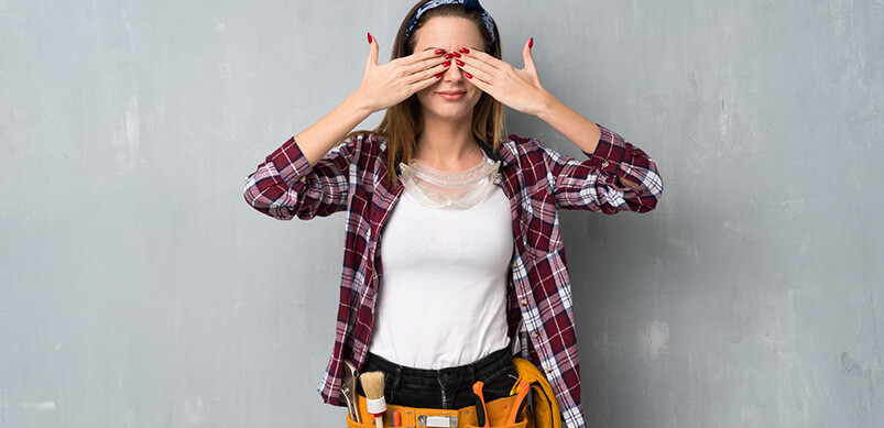 Woman With Tool Belt Shielding Eyes
