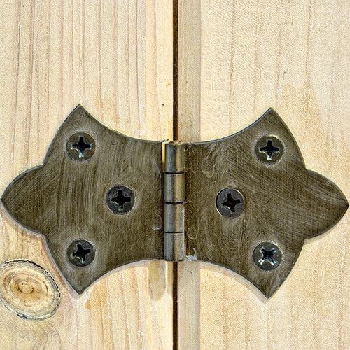 Close Up Of Door Hinge On Wooden Door