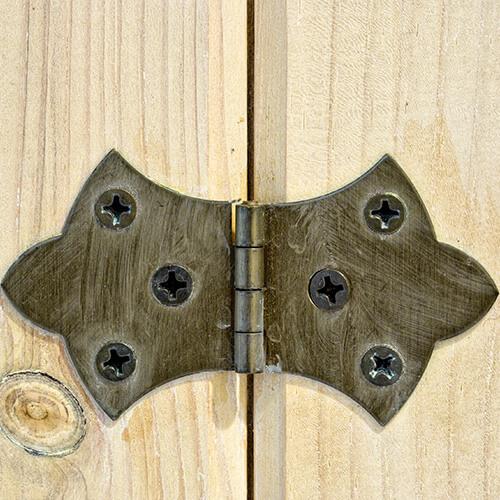 Close Up Of Door Hinge On Wooden Door