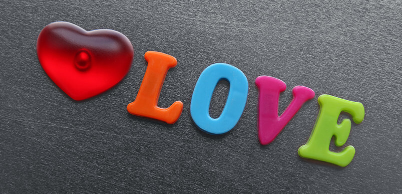 Word Love Spelled With Fridge Magnets