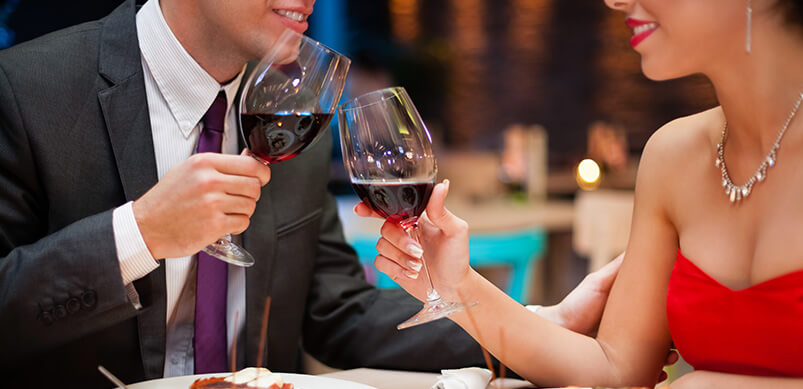 Couple Holding Wine Glasses On Date