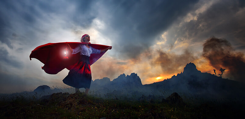 Woman With Cape On Mountain