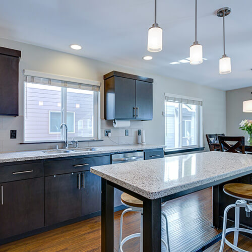 Long Lighting Hanging From Ceiling In Kitchen