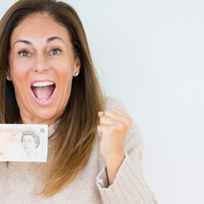 Woman Holding Ten Pound Note