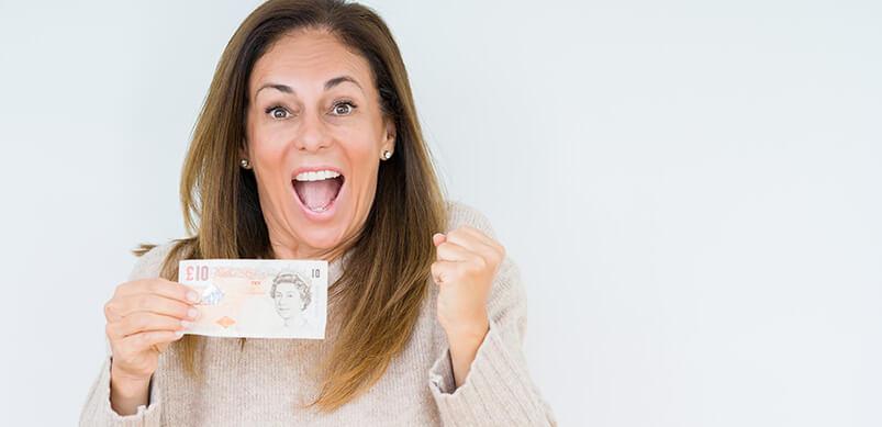 Woman Holding Ten Pound Note