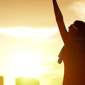 Woman Celebrating Outside At Sun Rise