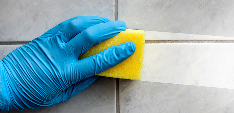 Sponge Cleaning Dirt From Tiles