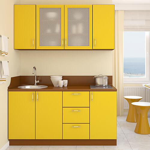 White Kitchen With Yellow Cupboards