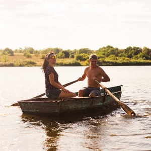Couple In Rowing Boat On Lake