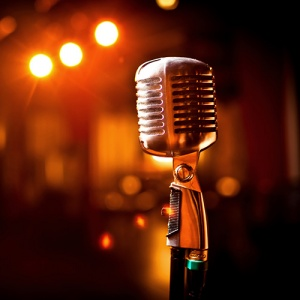 Microphone On Stage In Darkened Room