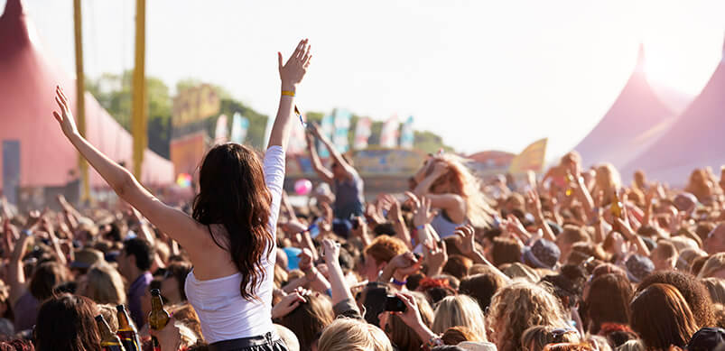 Crowds Cheering At Outdoor Music Festival